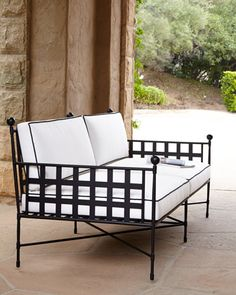 Water-repellent polyester cushions and metal frame, perfect for outdoor entertaining and comfort. From Neiman Marcus.