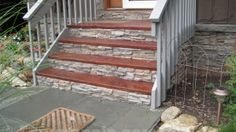 upgrade poured concrete entry steps by attaching stone panel facia