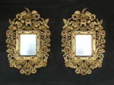 Rare pair of small, vividly carved gilt pine framed mirrors  adorned with coloured glass jewels and 3 birds forming crests, 18th Cent.