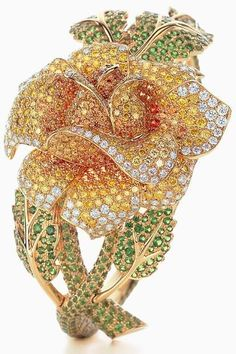 """""""Tiffany named tsavorite after Kenya's Tsavo National Park, where the intensely saturated green stone was discovered in 1970. In this rose bracelet from the Legacy Gemstones collection, tsavorites sparkle with yellow diamonds, white diamonds and spessartites."""" Via Tiffany and Co."""