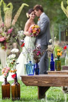 long wooden benches with flowers for your ceremony?