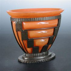 Daum, Nancy and Louis Majorelle, an orange glass vase with wrought iron frame, circa 1920