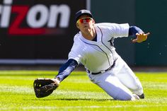 April 8, 2012; Detroit, MI, USA; Detroit Tigers left fielder Brennan Boesch (26) makes a diving catch on a hit by Boston Red Sox catcher Kelly Shoppach (not pictured) during the fifth inning at Comerica Park