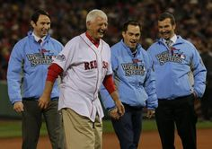 Boston, MA - 10/23/13 - Hall of Famer Carl Yastrzemski throws out the ceremonial first pitch with three medal of honor winners. The Boston R...
