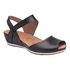 The Dansko Vera Peep Toe Sandal gives you the best of both worlds by combining the look of a wedge and the comfort of a flat. The stained cork midsole and a 2-tone rubber outsole complement each other