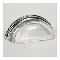 This transparent clear glass cabinet/drawer cup pull with traditional design is part of the Glass Bin Pull Series from Lew's Hardware. A hand poured glass bin pull with a polished chrome finish die cast zinc base. Perfect for use on cabinet doors and drawers capable of accepting a mounted pull, the design transforms the classic all metal fabrication into a unique transitional design with equal use within traditional and modern settings.