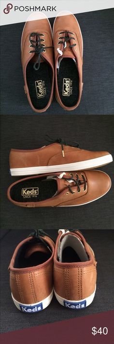 Brand New Burnished Leather Cognac Women's Keds New with box, never been worn. Classy dark denim lining and a soft leather feel. Size 6.5 US, EURO 37, UK 4. I wear 6.5/7 and am able to fit these well. Keds Shoes Sneakers