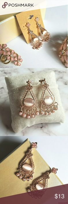 "Pale Pink Chandelier Earrings NWT Classy and elegant earrings ideal for a special occassion. Brand new. PRICE FIRM. No trades. Details: • 2"" drop • Features crystals and cat eye stone Jewelry Earrings"