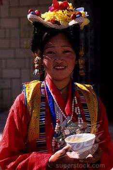 Tibet attire | CHINA, TIBET, LHASA, WOMAN IN TRADITIONAL DRESS, PORTRAIT