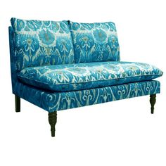 Ikat-inspired loveseat with pine wood legs. Handmade in the USA.   Product: LoveseatConstruction Material: Solid pine,...