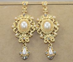 Cheap dress pig, Buy Quality earrings for gauged ears directly from China earrings abalone Suppliers: 2015 Baroque retro high qulity luxury gold alloy women earrings pearls drop luxury party dress earrings free shipping