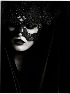 cloaked in black