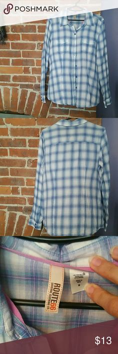 Cowgirl Up EUC This button up plaid shirt is one of my favorites. Soft to the touch material, a light blue and lavender color makes this the perfect feminine top to pair with your cowboy boots and show the boys what's what. MAKE AN OFFER Route 66 Tops Button Down Shirts