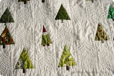 The tree / gnome  quilt is done and washed! I didn't long-arm it, a lady in Montana did. The back. Not a good photo but you can at least see...