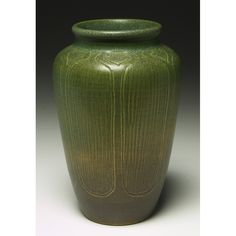 """North Dakota School of Mines vase, tapered form with incised trees covered with a green matt glaze, signed Reis-Huck, 2180, marked, 5""""w x 7.5""""h,"""