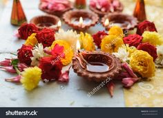 stock-photo-diya-lamps-lit-during-diwali-celebration-with-flowers-and-sweets-in-background-334000973.jpg (1500×1096)