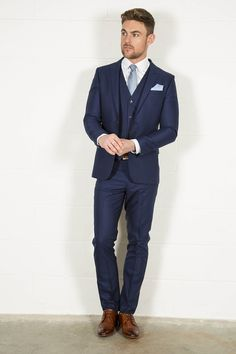 Dress dapper in this stylish plain blue slim fit three piece suit from the…