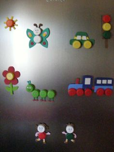Children's craft homemade magnets pop bottle lids and other items.