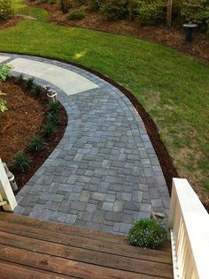 A paver walkway can add an attractive touch to your landscape. Interlocking paver base panels make this an easy project. We'll show you how to build it and give you ideas to turn a simple paving stone walkway into a focal point for your outdoors. Backyard Walkway, Outdoor Walkway, Front Yard Landscaping, Landscaping Ideas, Concrete Walkway, Paver Walkway, Paver Sidewalk, Walkway Ideas, Brick Pavers