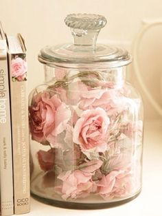 Jar with flowers to add a bit of color on coffee table.