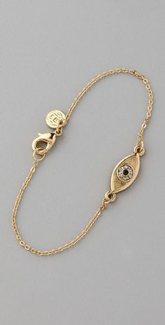 Another repin seen on a local style icon's Pinterest, Alyssa Dehayes. Charms like evil eye jewelry are like traveler's insurance for me.