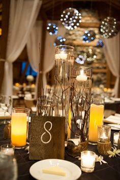Submerged branches with floating candles by Statice Floral, Brinton Studios
