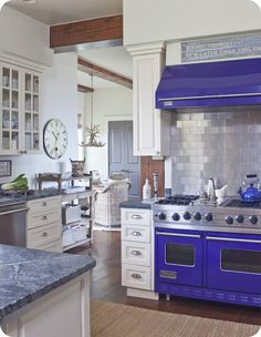 I love this Provencal Blue Viking Stove!!!  Love the Metal Backsplash!  ALso love the cabinets!  The only 2 changes would be Metal Counters instead of Granite & Retro Black & White or Grey & White Lanoleum FLoors