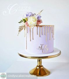 LOVE The gold drip with the color cake and colorful flowers!!