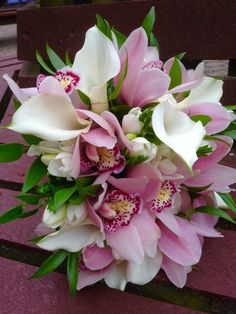 Our discerning bride asked for beautiful classic wedding flowers, calla lilies, cymbidium orchids and freesia to create her bridal bouquet with. www.am-flowers.co.uk