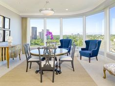 Home of the Week: High-Rise Luxury in Oak Lawn | Large rooms with wraparound windows flow easily for both entertaining and daily living. The dining area offers anincredible night time view of the downtown Dallas skyline which will captivate your guests. | 3510 Turtle Creek Boulevard 9C