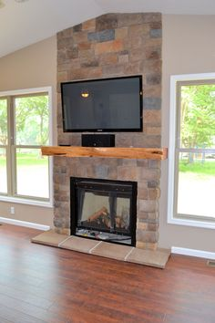 Interior : Architecture Fireplace Stone Wall And Electric Fireplace With Tv Above And Wooden Flooring Tiles Installation And Light Brown Wall Paint Fireplace Stone Wall Decoration Ideas For Modern Home Fireplace With TV Design Ideas Fireplace Mantels Designs. Fireplace Design. Fireplace Mantel Designs.