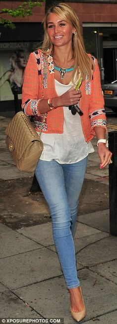 Stylish: The blonde star looked effortlessly chic in an orange patterned boucle jacket, white vest, denim skinny jeans and nude pointed stilettos, while toting an envy-inducing Chanel quilted handbag