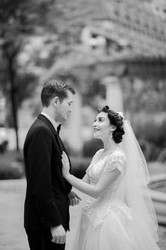 Lovely classic wedding photo. Modest lace and tulle 50's wedding dress.   Wedding Photography: Emilia Jane Photography / Wedding Venue: Signature Room at the 95th in Chicago, Illinois / Floral Design: Signature Room / Wedding Invitations: Designed by the Bride / Wedding Dress: A Borrowed Vintage Dress / Bride's Shoes: Nina