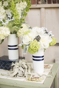 Two pieces of navy ribbon wrapped around plain white vases sets the stage for this color combo. Source: Eva Derrick Photography.  #DIY #weddingdecor #flowervases