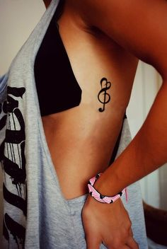 Treble/heart tattoo--I've never seen one this way, I love it! Could be couple tattoo?