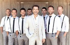 Good beachy look for the groomsmen without having a theme color for them.. I hope they're all this hot!