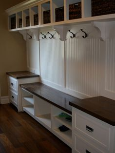 Mudroom with nice bench separation, but not sure if there is enough length for our coats though.
