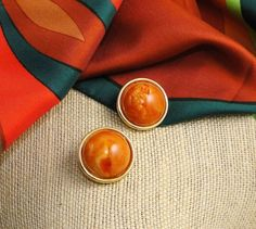 Vintage Adventure eBay listing ends Oct. 1, 2014. Vintage Kenneth Jay Lane ~ KJL domed Lucite earrings. Marbled orange, brown and cream culminating in a yummy pumpkin pie swirl. Photos may show Lucite as a bit more orange than they are. They lean more toward sienna brown. All set in goldtone and signed Kenneth Lane on the backs of the clips. Perfect fall accessory.