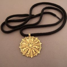 """For this first days of january ...   18ct gold, Ethiopia   Description :  A beautiful """"solar"""" pendant (early 20th c.) in solid 18ct gold with a filigree design that makes it very airy and wearable ... a pendant dating from the early 20th century ...  Weight:15gr  Diameter::1,574 inch/4cm ...For sale now in my Gallery at 28, Galerie du Roi at 1000 Brussels and online www.halter-ethnic.com, item """"My Lucky Finds"""""""