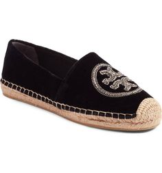 A chain-link logo medallion lends edgy signature style to a sleek velvet espadrille flat that makes for a luxe off-duty style.