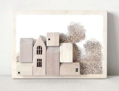 Miniature wood houses and wood wall sculptures beautifully handcrafted by Says The Tree.