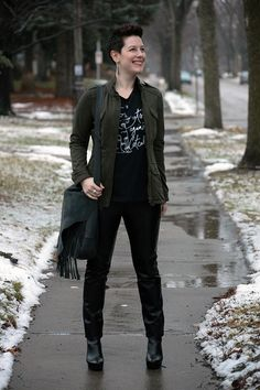 Already Pretty outfit featuring military jacket, Feminist Apparel shirt, leather pants, black ankle boots, fringe handbag