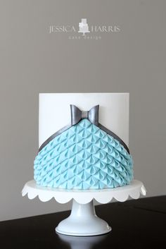 Pale blue and white ruffle wedding cake with silver bow ~ we ❤ this! moncheribridals.com