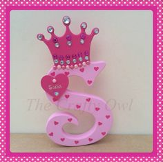 Hand painted wooden initials can be painted in any colours and can have any design painted on or covered in a theme, these are available to order with or without a crown on the top. each letter can have a wooden name tag added, they are also finished with embellishments to match. Each initial is £10 plus postage or £11.50 with a crown. https://www.facebook.com/TheCraftyOwl46?fref=photo