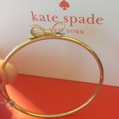 """Kate Spade Skinny Mini Bow Bangle Bracelet Color: Gold.              """"Skinny Mini"""" Love Notes Bow Bangle New with Tags & Pouch A slender crystal bangle with a bow creates a very feminine look. 7"""" inner circumference; 2""""W x 1""""L setting. Inner circumference: 7"""" Closure: Magnetic Imported Comes with Kate Spade Pouch as shown kate spade Jewelry Bracelets"""