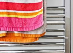If simply hanging your towel over the edge of the shower door isn't enough, you may want to invest in a heated towel warmer. They are usually mounted to the wall, and will warm up your towel all the while that you are in the shower. Bathroom Heater, Towel Radiator, Towel Warmer, Heated Towel Rail, Simple Bathroom, Shower Doors, Bathroom Inspiration, Tile Floor, It Is Finished