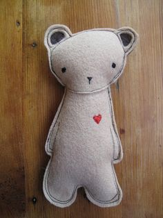 Small stuffed bear with heart
