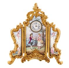 A Continental Enamel and Gilt Metal Three Panel Table Clock Height 4 3/4 in