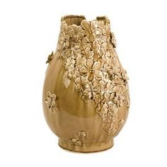Bring a touch of style to your favorite space with this eye-catching accent, featuring detailed craftsmanship and chic appeal.     Product: Vase  Construction Material: Ceramic   Color: Gold   Features: Hand-applied applique  Dimensions: 11.25 H x 9 Diameter