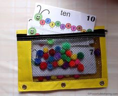This is a brilliant caterpillar busy bag from Powerful Mothering.  She is offering a FREE PRINTABLE with the caterpillars.  You just need the pom-poms.  Children learn counting as well as sequencing and color matching!  Love it!  #preschool #caterpillar #math